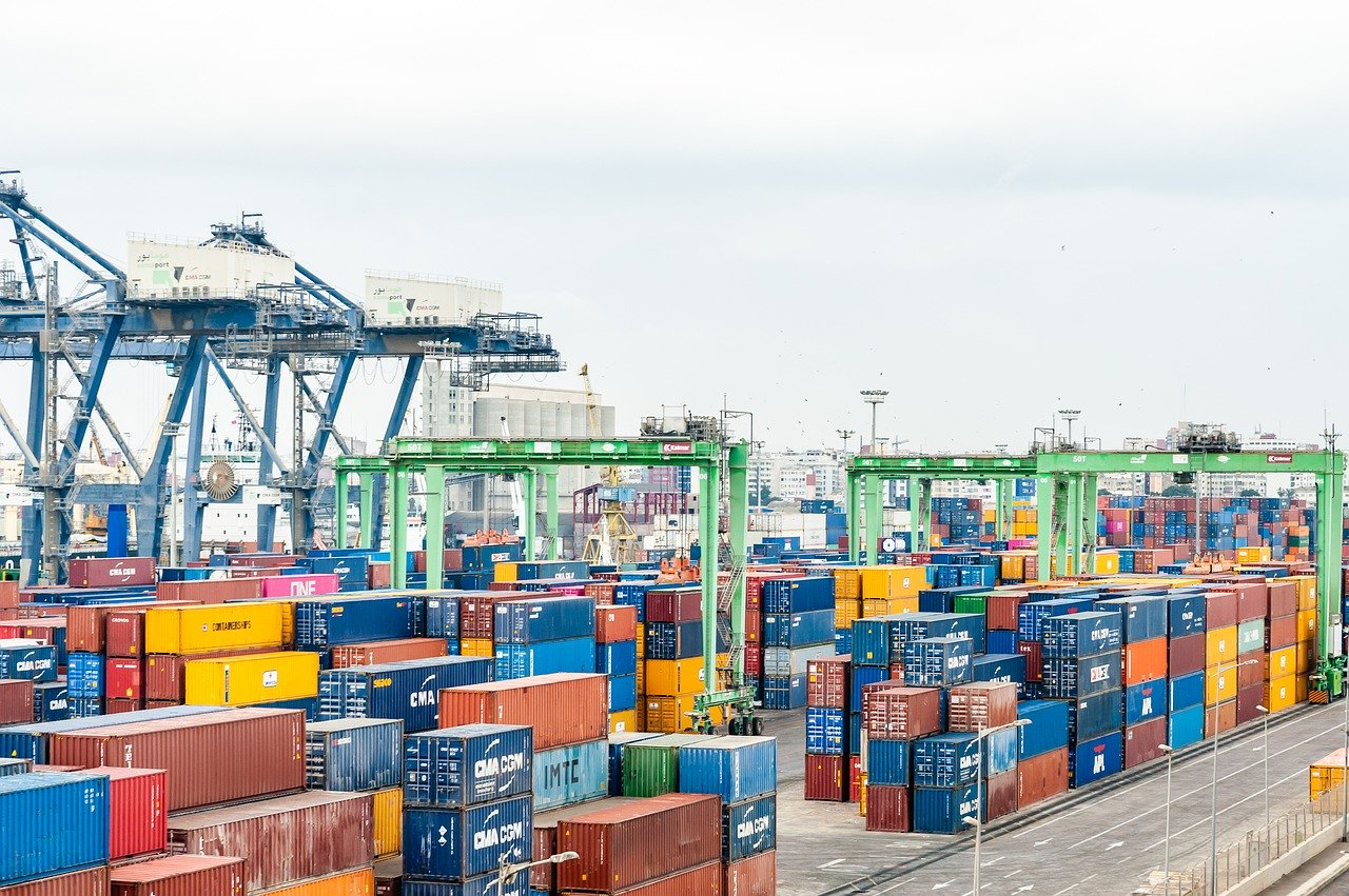 Busy sea shipping port with shipping containers