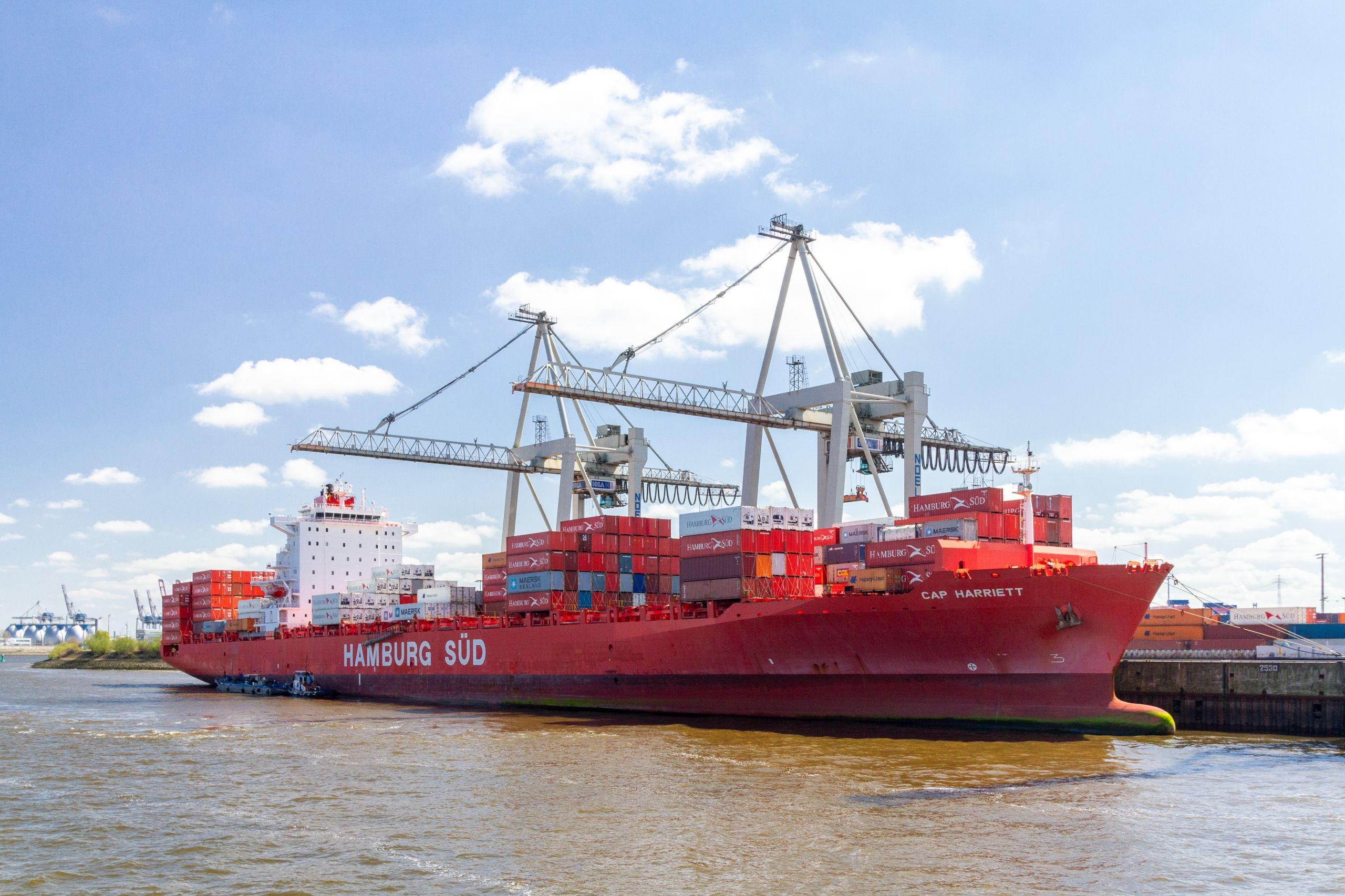 a red coloured shipping vessel